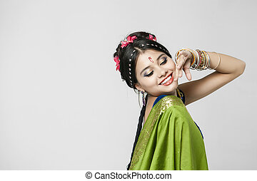 Young pretty woman in indian green dress