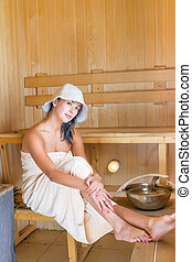 Young pretty woman in sauna
