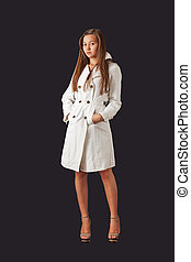 Young pretty woman in white raincoat