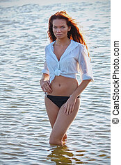 Young pretty woman in white shirt