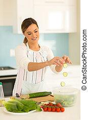 pretty woman making green salad