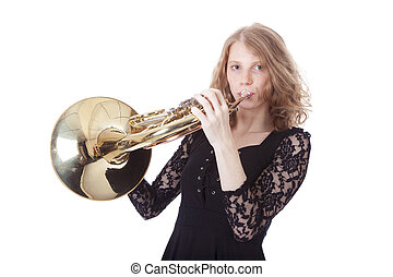 young pretty woman playing french horn against white background