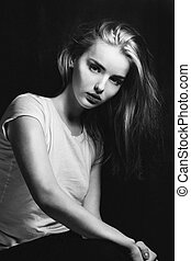 young pretty woman portrait black