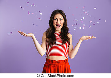 Young pretty woman posing isolated over purple background...