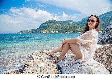 Young pretty woman posing sitting