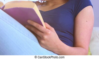 Young pretty woman reading a book
