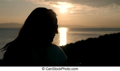 Young Pretty Woman Silhouette By The Shore At Sunset