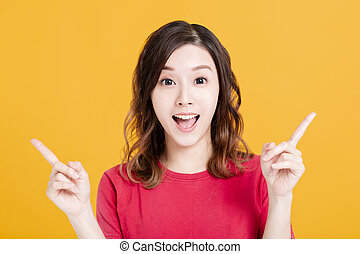 Young pretty woman smiling and pointing something