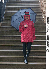 Young pretty woman standing in the rain