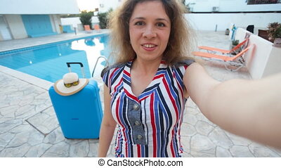 Young pretty woman taking selfie on vacation