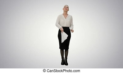 Young pretty woman throw papers finishing work successfully on white background.