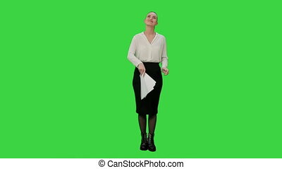 Young pretty woman throw papers finishing work successfully on a Green Screen, Chroma Key.