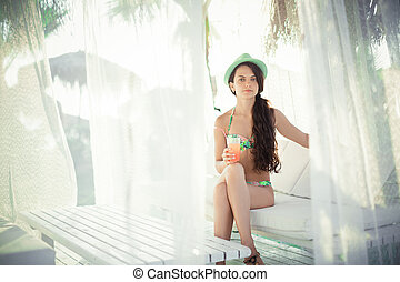 woman with a cocktail on the terrace