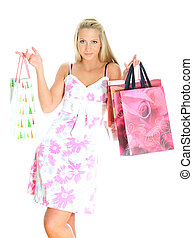 Young pretty woman with shop bags. Isolated on white