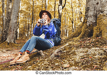 Young Pretty Woman With Walking Sticks In A Forest