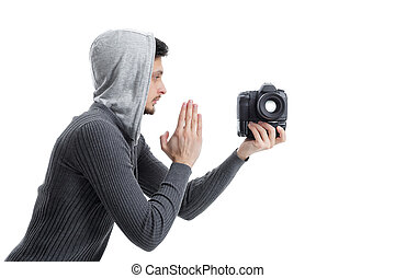 young professional photographer prays for DSLR digital camera is