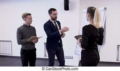 Young professional team work on startup project standing in modern office.