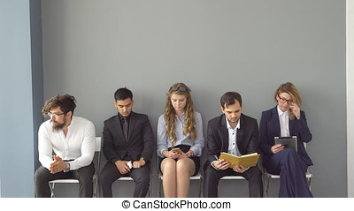 young professionals on job interview. University graduates...