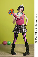 Young punk woman with a big lollipop