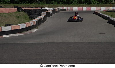 Young racer at go-kart racetrack circuit championship ...