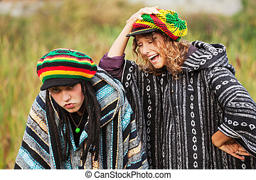 Young Rastafarian couple in a city park