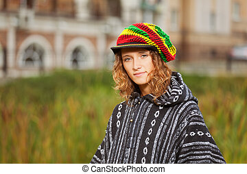 Young rastafarian woman on a city street