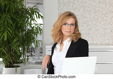 Young receptionist sitting at a desk