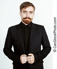 young red hair man with beard and mustache in black suit on...