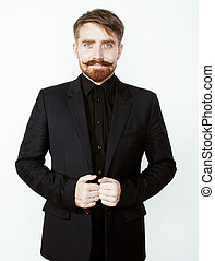 young red hair man with beard and mustache in black suit on white background