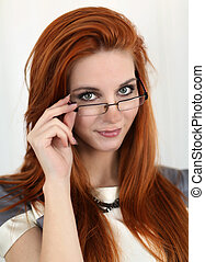 Young red hair woman with glasses