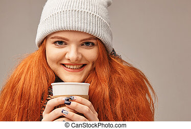 red-haired girl basking in coffee