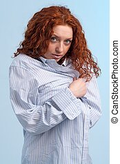 young red-haired woman in shirt