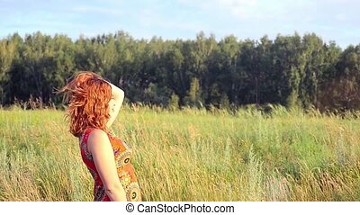 young red-haired woman with full red lips posing to...