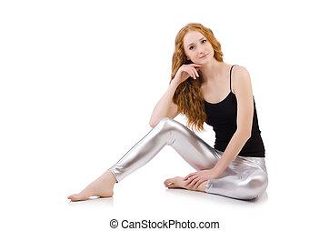 Young redhead girl in tight leggings
