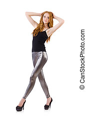 Young redhead girl in tight leggings