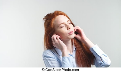 Redhead Girl Listening Music - Young Redhead Girl Listening...