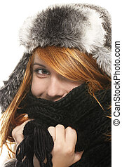 young redhead woman covering in muffler on white background
