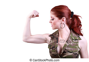 Young redhead woman flexing biceps showing strength
