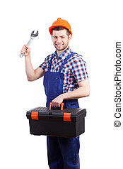Young repairman holding toolbox and spanner