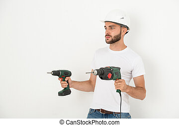 Young repairman with hand tools
