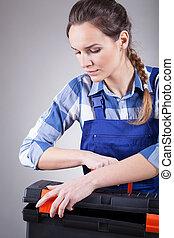 Young repairwoman at work