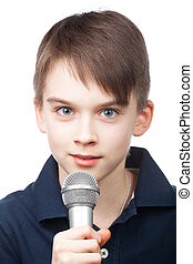 Young reporter - Cute boy holding microphone on white...