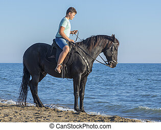 young rider on the beach