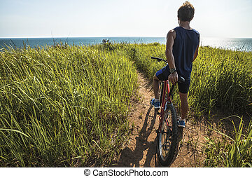 Young rider with a bike