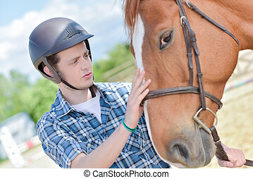 young rider with horse