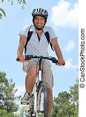 Young riding bike