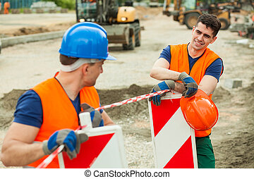 Young road construction workers