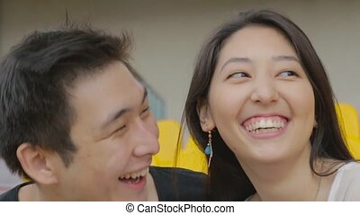 Young romantic asian couple on a date feeling happy in slow motion