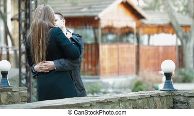 Young romantic couple embracing outdoors
