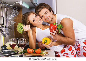 Young romantic couple in the kitchen